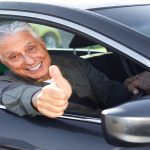 Old man car driver in vehicle. Transportation insurance concept